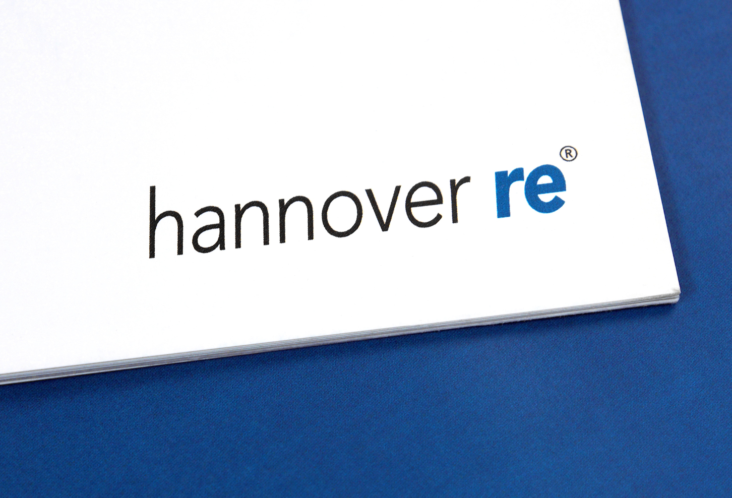 The Hannover Re logo on a white and blue background