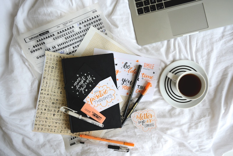Planner stickers, markers, and a coffee mug